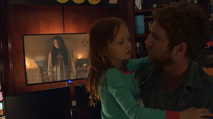 Left to right: Chloe Csengery plays Katie, Ivy George plays Leila, and Chris J. Murray plays Ryan in Paranormal Activity: The Ghost Dimension from Paramount Pictures.